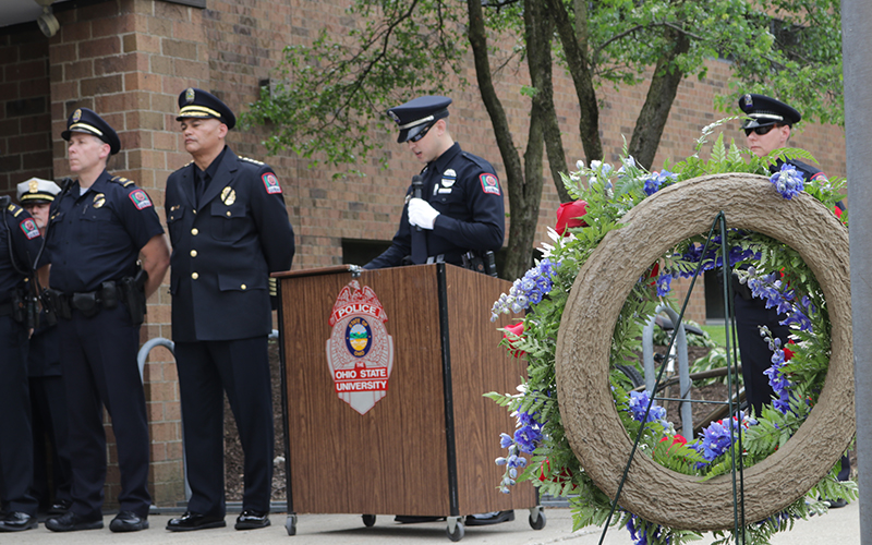 officers at a memorial ceremony in front of Blankenship Hall