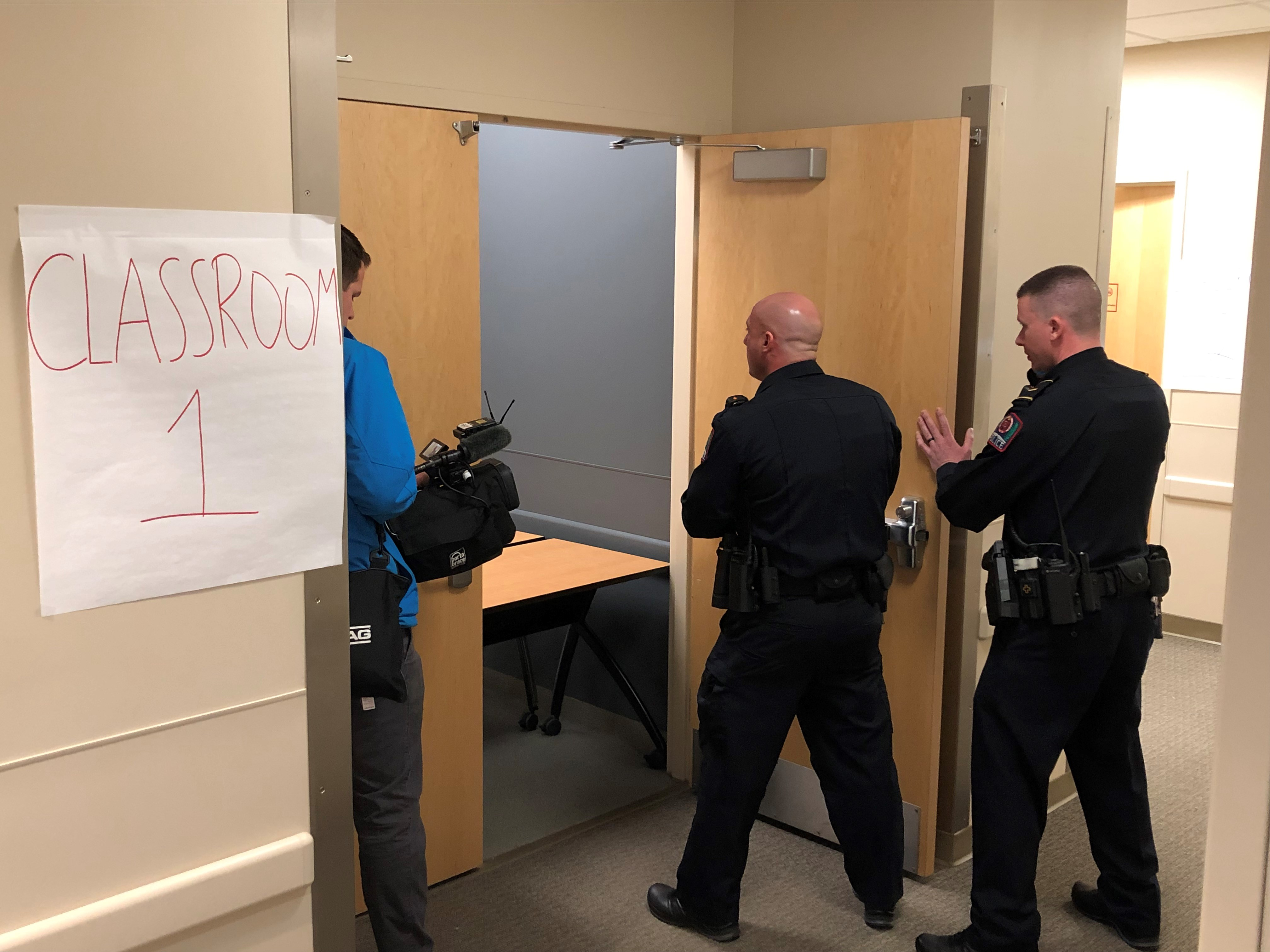 screen grab of active shooter training, three officers going though a door