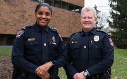 the chief and deputy chief standing in front of Blankenship Hall