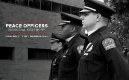 police officers at a memorial service in front of Blankenship Hall