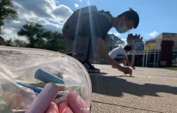 Photo of students drawing with chalk