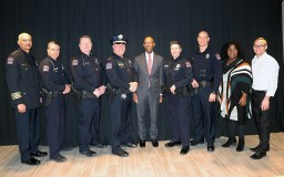 President Drake and DPS officials posing for a photo at the awards ceremony