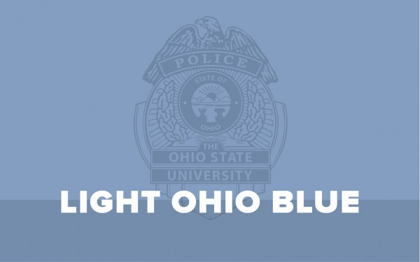 a sign of a police badge with the words in front of it, light ohio blue