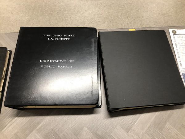 two books of historic records on a table